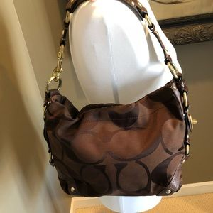 Woman's brown authentic coach purse.